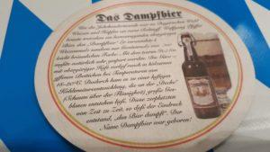 """Bieruntersetzer, der erklärt, dass sich der Name """"Dampfbier"""" vom Schaum her ableitet."""